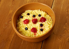 Millet porridge with berry Stock Photography
