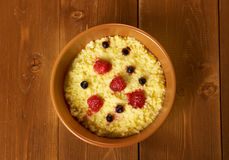Millet porridge with berry Stock Images
