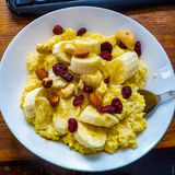 Millet porridge with cherries, bananas and nuts Royalty Free Stock Photos