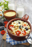 Millet porridge with dried apricots and prunes Royalty Free Stock Images