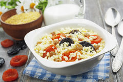 Millet porridge with dried apricots and prunes Royalty Free Stock Photography
