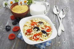 Millet porridge with dried apricots and prunes Stock Images