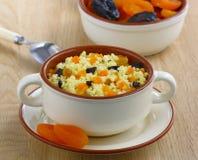 Millet porridge with dried fruit Stock Photos