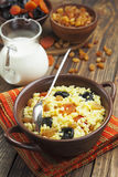 Millet porridge with dried fruit Royalty Free Stock Images