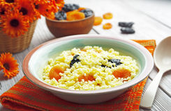 Millet porridge with dried fruit Royalty Free Stock Photo