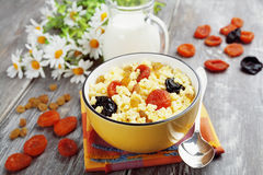 Millet porridge with dried fruit Stock Photography