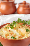 Millet porridge and fat, potatoes and onions Stock Photos