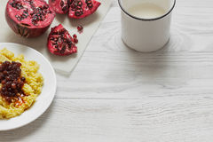 Millet porridge with milk, fruits and nuts. On a wooden background Royalty Free Stock Images