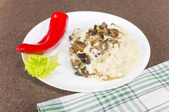 Millet porridge with mushrooms Stock Images