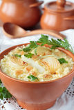 Millet porridge with onions and fat in bowl Royalty Free Stock Photo