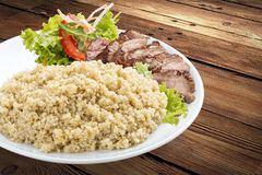 Millet porridge with pork grilled. royalty free stock image