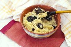 Millet porridge with prunes Royalty Free Stock Image