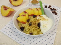 Millet porridge with yogurt, cinnamon, peach Stock Photos