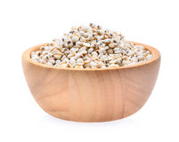Millet rice , millet grains in wooden bowl isolated on white bac. Millet rice , millet grains in wooden bowl isolated on white Stock Photos