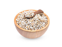 Millet rice , millet grains in wooden bowl and spoon isolated on. White Stock Photography