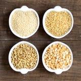 Millet, spelt, bulgur and yellow peas Stock Images