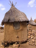 Millet store. House in mali, africa with decoreated door Royalty Free Stock Photo