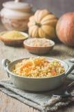 Millet with sweet pumpkin. Millet porridge with sweet pumpkin in a bowl, rustic style. Healthy vegan dish stock images