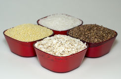 Millet, white rice, barley and oats Stock Photos