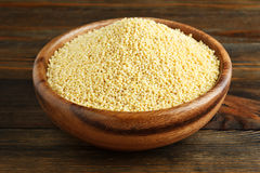 Millet in a wooden bow Royalty Free Stock Images