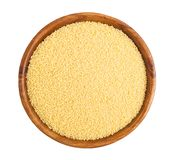 Millet. Wooden bowl full of millet Royalty Free Stock Photo
