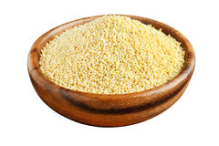 Millet in a wooden bowl Stock Photo