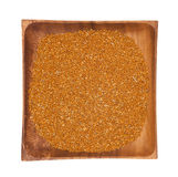Millet in a wooden bowl on white background Stock Images