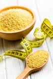 Millet in wooden spoon Stock Images