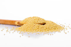 Millet in a wooden spoon Stock Photography