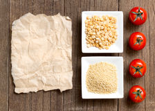 Millet and yellow peas, tomatoes and paper Stock Photo