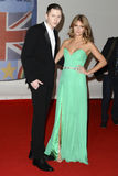 Millie Mackintosh, Professor Green. Professor Green and Millie Mackintosh arriving for the Brit Awards 2012 at the O2 arena, Greenwich, London. 21/02/2012 Stock Photos