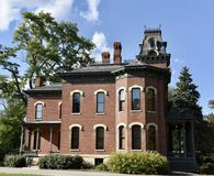 Millikan Mansion. This is a Summer picture of thehistoric James Millikan Mansion located in Decatur, Illinois in Macon County. This two-story brick mansion is an Royalty Free Stock Photos