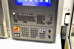 Milling CNC machine control panel with display. Selective focus stock photography