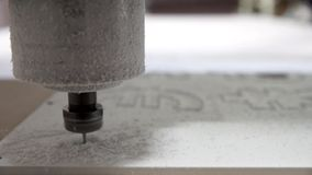 Milling cutting machine makes cutting currency stock video footage