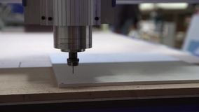 Milling cutting machine makes a plotter cutting in plastic stock video footage