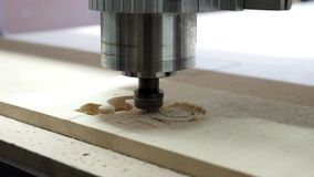 Milling cutting machine makes in wood POUND stock video footage