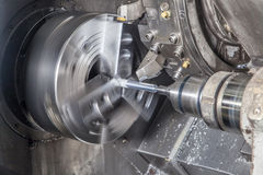 Milling detail on metal cutting machine Royalty Free Stock Photo