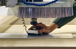 Milling and engraving machine. Hand of worker using milling and engraving machine Royalty Free Stock Images