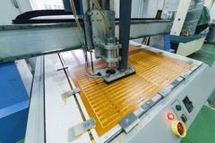 Milling engraving machine. The machine cuts blanks for electronic printed circuit boards stock photography