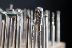 Milling heads on a goldsmith workplace, macro shot of  jewelry t. Ools against a dark background, selected focus, narrow depth of field Royalty Free Stock Images