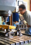 Milling Machine. An operator working on milling machine Royalty Free Stock Photography