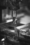 Milling machine for carving metal. Black and white image. Vertical Stock Images