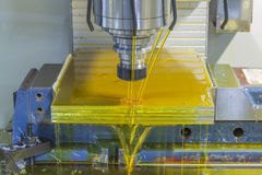 Milling machine CNC with oil coolant Royalty Free Stock Photo