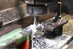 Milling machine operations India. Metl removing operations on milling machine in metal removing industrial shoot Stock Images