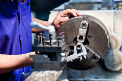 Milling machine operator working in factory Royalty Free Stock Photo