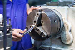 Milling machine operator working in factory Royalty Free Stock Image