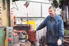 Milling machine operator works Stock Images