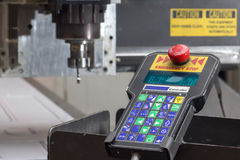 Milling machine for processing plastics and remote control Stock Image