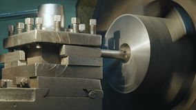 Milling machine produces metal detail. On factory. Deep field of view. Heavy industry concept video stock footage