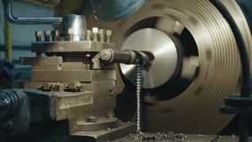 Milling machine produces metal detail on factory. Deep field of view. Heavy industry concept video stock footage